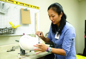 Jocelyn Wong, clinical director, modifies a below knee mold at the Independence Prosthetics Orthotics new office at the UD STAR campus, Monday, Sept. 21, 2015. Photo by Tim Hawk