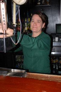 Nichol DiMarzio pours a Yuengling lager upstairs at Kelly's Logan House. (Photo by Anthony Santoro)