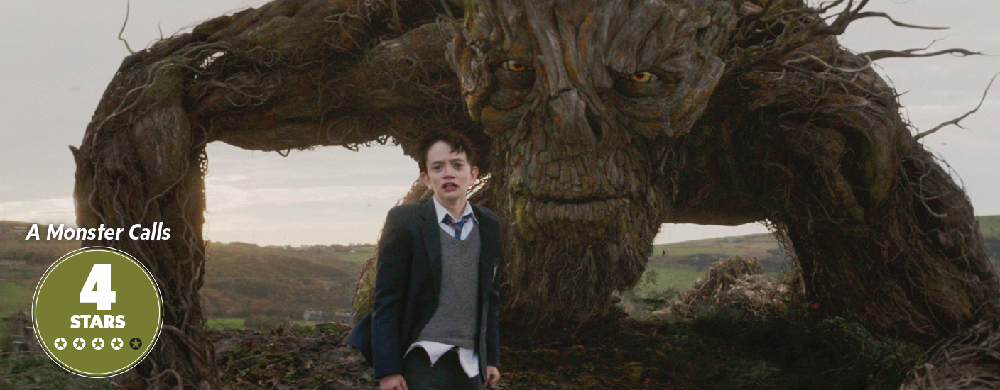 Conor (Lewis MacDougall) is shadowed by The Monster (performed and voiced by Liam Neeson) in A Monster Calls. Photo courtesy of Focus Features