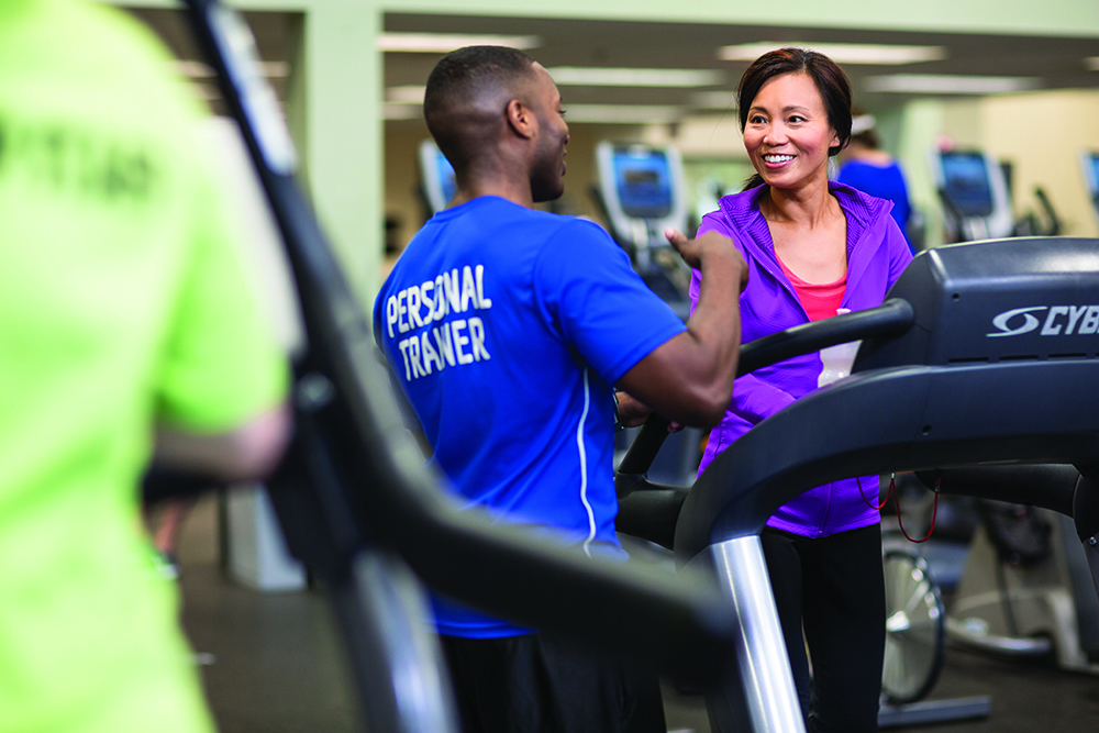 A personal trainer at the YMCA coaches a client on the treadmill. (Photo courtesy of the YMCA)