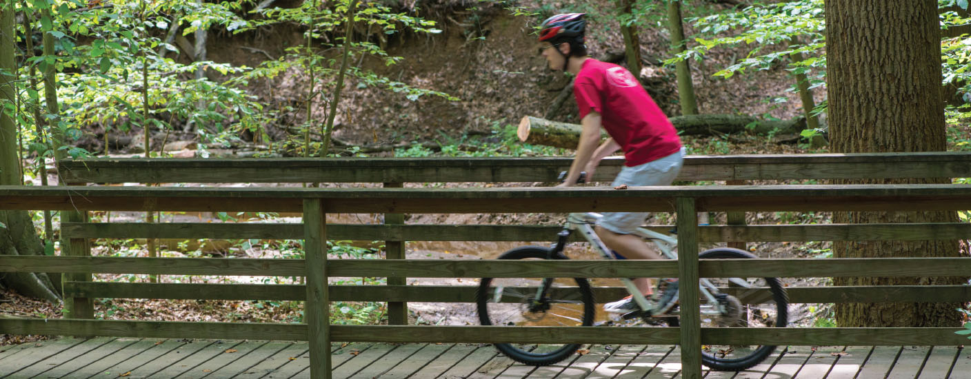 A cyclist on a trail in White Clay Creek State Park. Photo Joe del Tufo