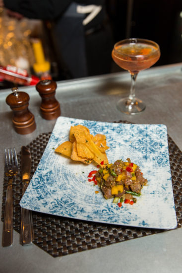 The Market's Tuna Poke and sesame crisps with a handcrafted cocktail. Photo by Matt Urban.