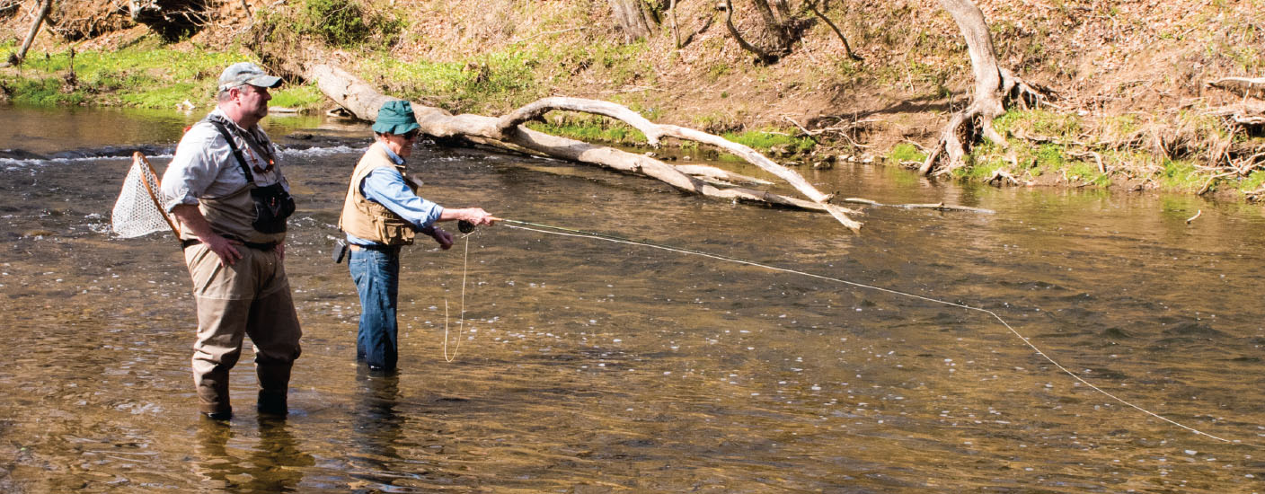 Sans boots, the intrepid author fishes a stretch of White Clay Creek under the tutelage of Tim O'Neill. (Photo by Anthony Santoro)
