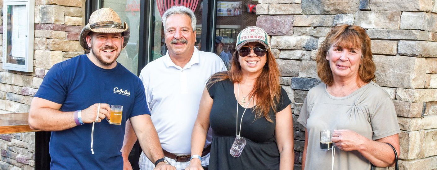 Joe Mullen, Joe Barone, Angela Barone and Risa Mazzetti Parrish outside of The Stone Balloon Ale House, at last year's Newark Food & Brew Festival. Photo Anthony Santoro