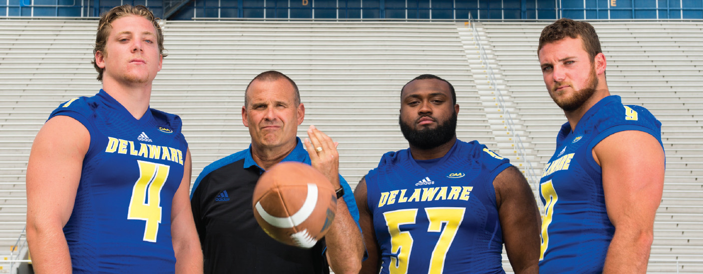 New Coach Danny Rocco with some of the in-state talent on his defense: (l-r) Colby Reeder, Grant Roberts and Troy Reeder. Photo Moonloop Photography