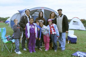 A family poses in front of their tent at Carousel Park. (Photo provided by New Castle County Government)