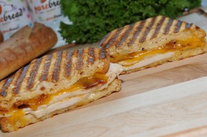 "The ""Jack Russell,"" a grilled panini with chicken, bacon, cheddar cheese, peppercorn and ranch dressing, is PureBread's most popular sandwich. (Photo provided by PureBread Deli + Cafe)"