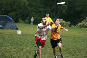 Alex Grintsvayg and Kristen Frentzel fight for the disc during a game. (Photo by Matt Jones)