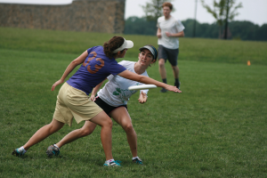 Keala TeKolste defends against Arwin Thomasson. Players must keep the disc moving. (Photo by Matt Jones)