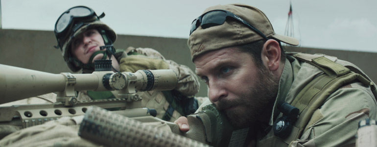 (L-r) Kyle Gallner as Goat-Winston and Bradley Cooper as Chris Kyle in American Sniper. Photo courtesy of Warner Bros. Pictures.