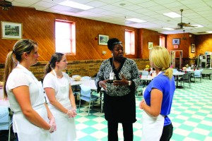 Volunteers receive instructions before lunch at Emmanuel Dining Room. (Photo Ministry of Caring)