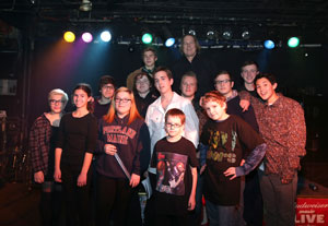 Eric Svalgard (back row) and some of his students. Unlike traditional bands, School of Rock students have to learn how to play with everyone. (Photo by Tim Hawk)