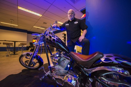 Kjell Hegstad parks his customized motorcycle inside 1313. Digital Vikings, his mobile design and development business, is a primary user of the facility.