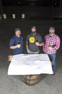 From left, Mike Stiglitz, partner, Bob Barrar, owner/brewer and Mike Contreras, director of marketing and sales stand in the warehouse where 2SP Brewing Company will be located in Aston Pa. (Photo by Tim Hawk)