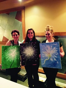 Bethann Patterson, Heather Wilson and Devin Zebley (l-r) show paintings from an UnTapped Artistry paint party at McKenzie Brew House. (Photo courtesy of UnTapped Artistry)
