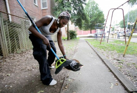 Shamika Miller cleans up the fourth street park in Wilmington, Saturday, July 18, 2015. (Photo by Tim Hawk)