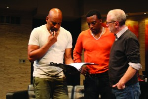 David Robson (R) goes over lines with Ezra Knight and Garrett Lee Hendricks during a rehearsal. (Photo by Breck Willis, Delaware Theatre Company)