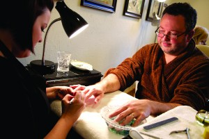 "Matt, in his ""teddy bear robe,"" enjoys the mani part of the mani-pedi."