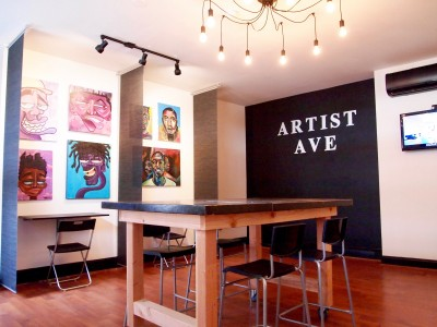 Artist Ave Station features a ground-level co-working area that doubles as an art gallery.