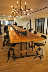 Herrera installed this custom-made 28-foot-long table, made from American chestnut, and outfitted it with electrical and internet connections for 18 users. (Photo by Joe del Tufo)