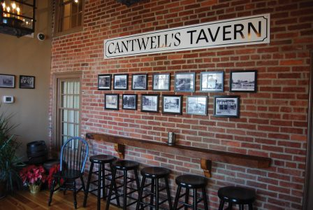 Historical photos line the wall at Cantwell's Tavern in Odessa. (Photo courtesy of Cantwell's Tavern)