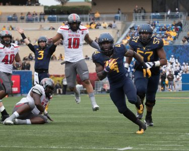 Last season at West Virginia, Smallwood ran for 1,519 yards on 238 carries, for an average of 6.4 yards. (Photo courtesy of Brent Kepner/WVU)
