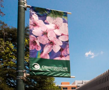 Light pole banners at Christiana Care's Wilmington campus, an example of banner stiching with Precision Color Graphics' industrial-grade Singer sewing machine. (Photo courtesy of Brett Schoen/One Light Imaging)