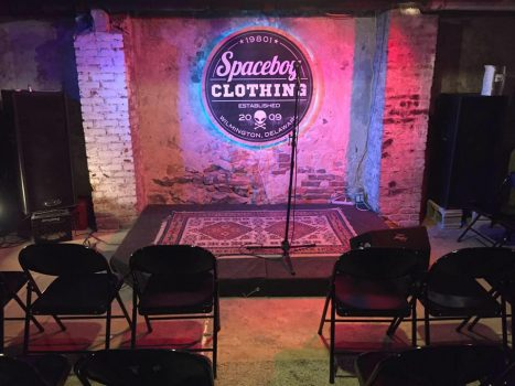 "Spaceboy Clothing's basement ""comedy club."""